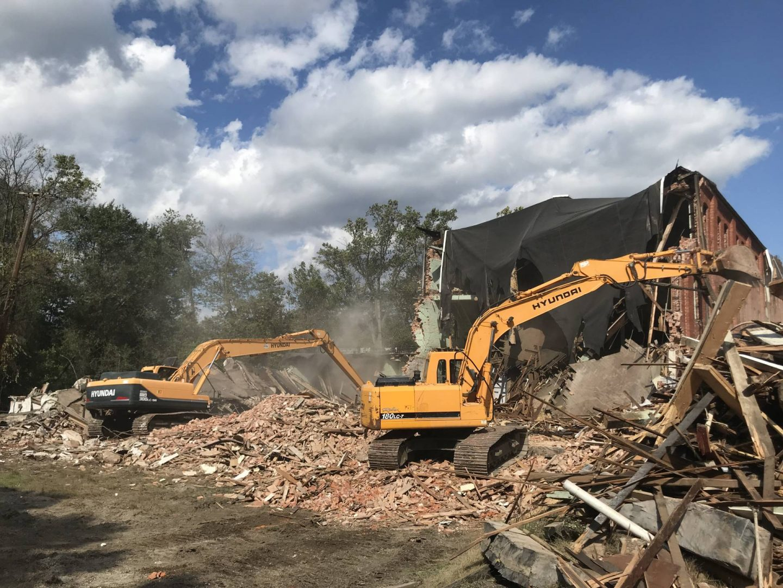 demolition company demolishing building