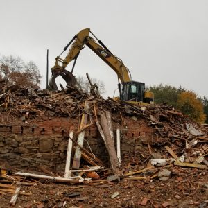 brick building being demolished by demolition company