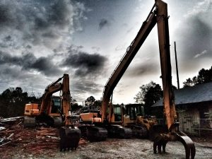 demolition backhoes sitting on job site after day of work