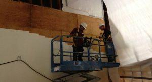 two demolition professionals standing on platform preparing job site for demolition